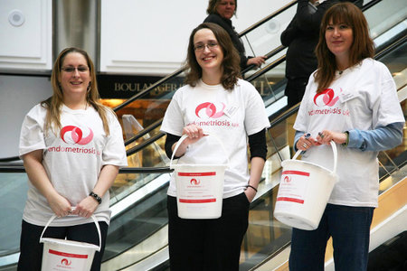 A group of endometriosis uk fundraisers stand with collection tins
