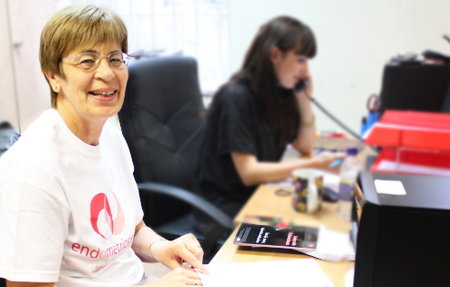 Endometriosis UK volunteer sits at her desk