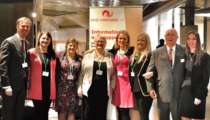 Endometriosis UK representative stand with members of the Scottish Parliament