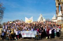 The crowd gathers for a photo for the UK million woman march for endometriosis